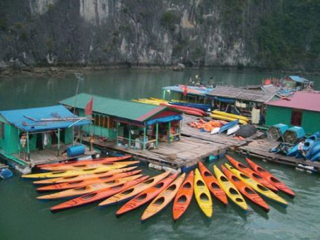 Tourists visit fishing villages when going kayaking