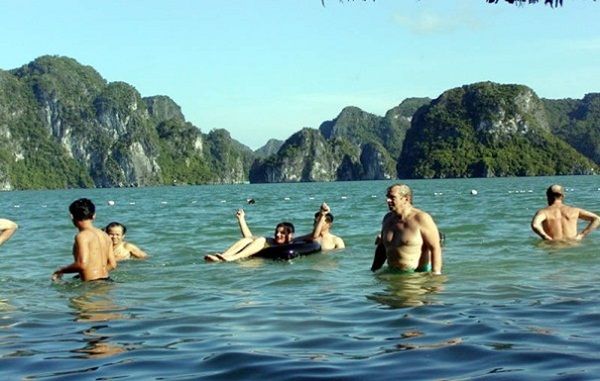 Tourists swimming in Halong Bay