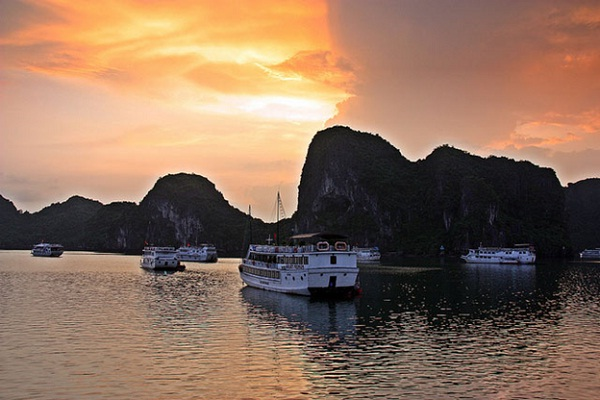 Enjoy stunning sunset on our luxury cruise on your trip to Halong Bay