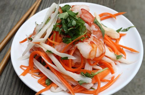 Vietnamese lotus root salad has colorful of carrot, lotus, celery…