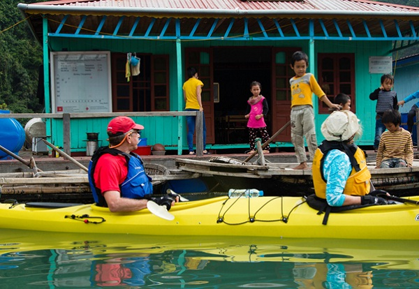 Kayaking to meet friendly locals