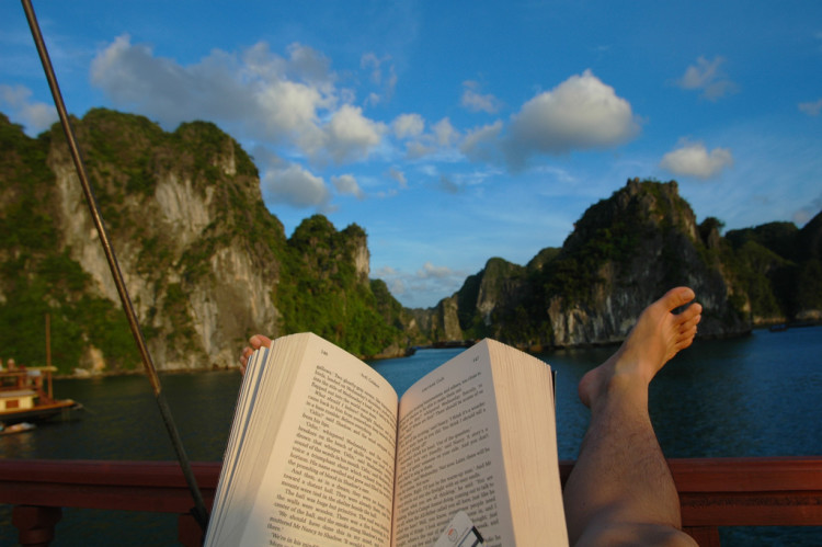 Reading book in Halong Bay