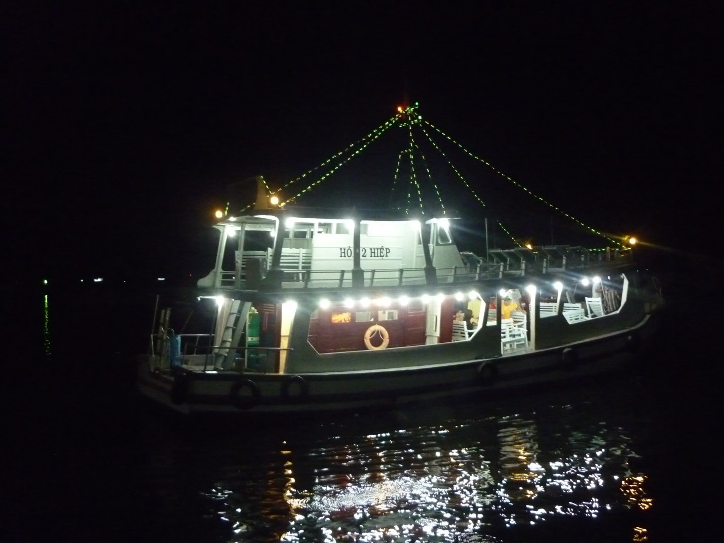 The boat which serves tourists to fish squids at night in Halong Bay