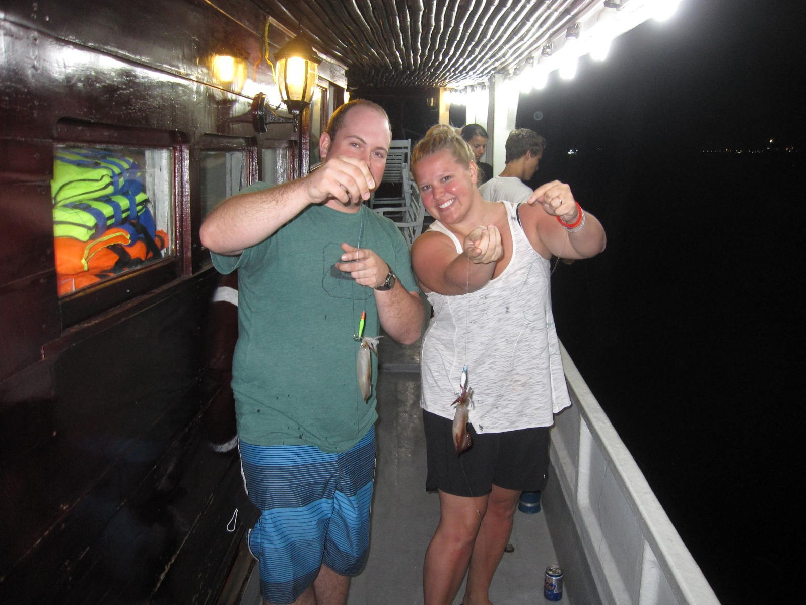 The happiness of visitors when fishing squids at night in Halong Bay