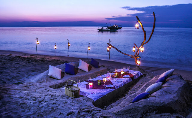 Enjoy the romantic BBQ on the beach at night