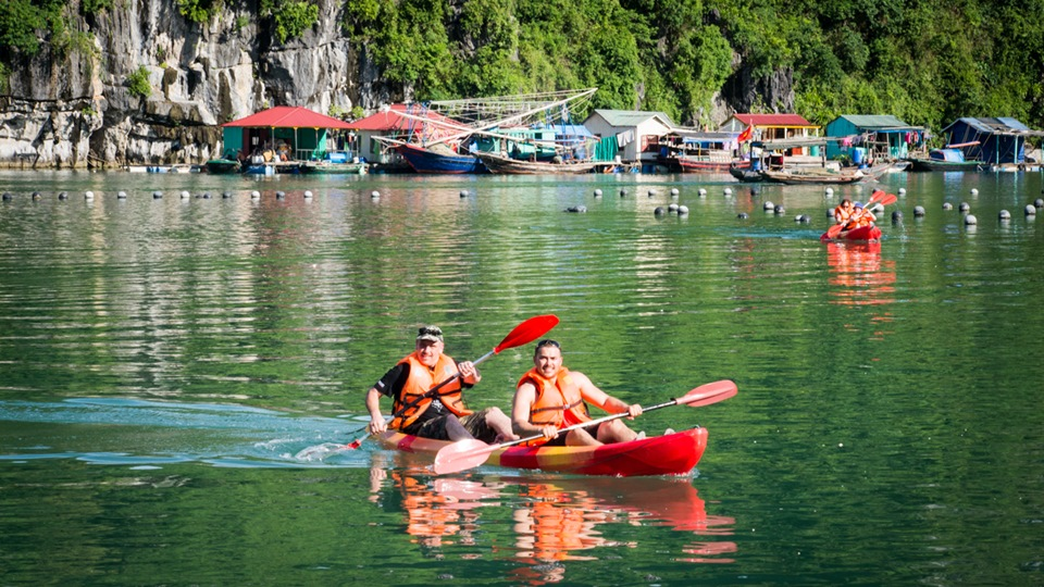 Kayak to visit floating villages in Halong Bay