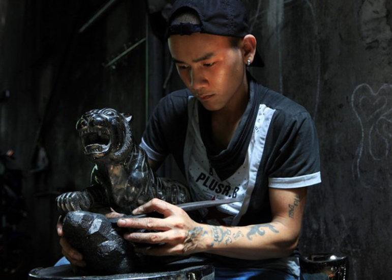 Fine handicraft coal statues Halong Bay