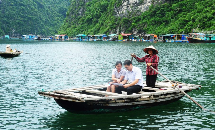 Explore Cua Van Fishing Village on the boat