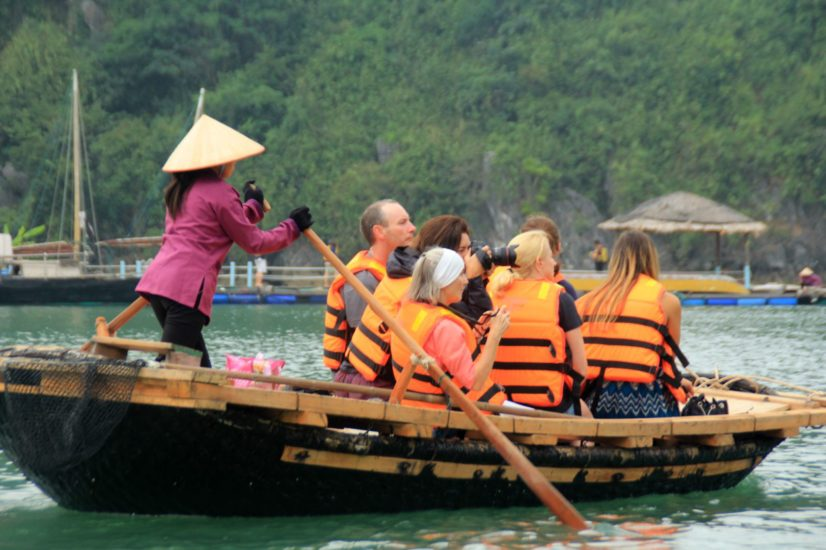 The excitement of tourists when visit Vung Vieng Fishing Village on the boat