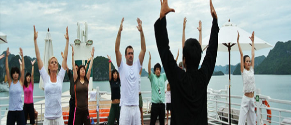 Tourists participate in tai chi activity at the break of dawn on Huong Hai Sealife