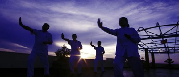 Tai Chi practice on Halong Bay Overnight Cruise